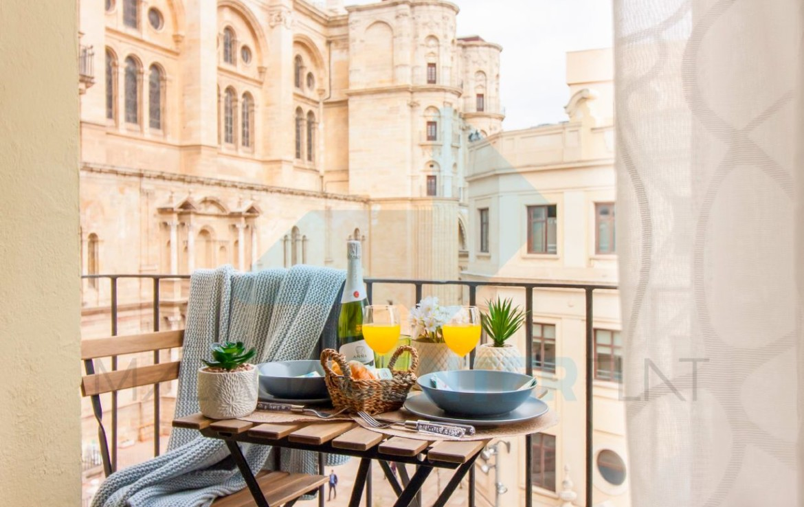 balcony and cathedral in Malaga